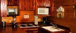 Extended stay vacation kitchen in Nature's Heart Cabin
