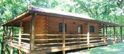 Hot Tub and wrap around porch on a cabin in Eureka springs Arkansas